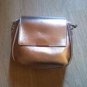 Ion color brillance metallic rose gold bag (NWOT)